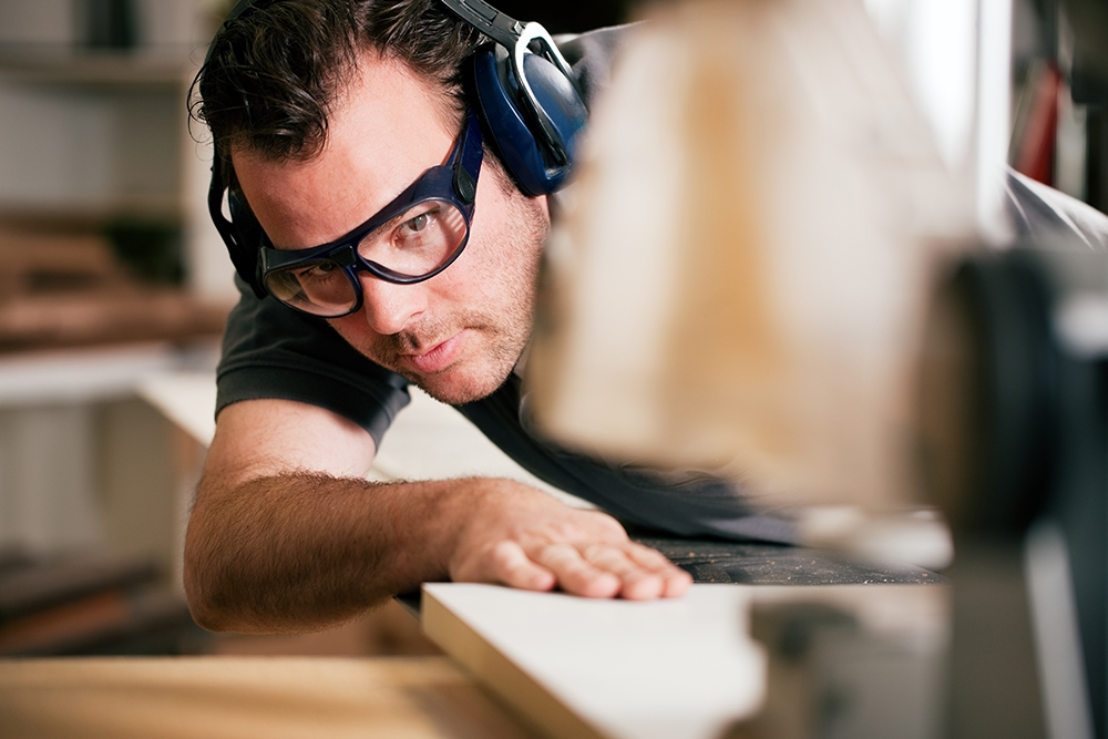 man wearing hearing protection in the workplace