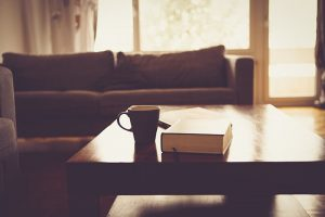 mug and book on a table in a living room with good indoor air quality